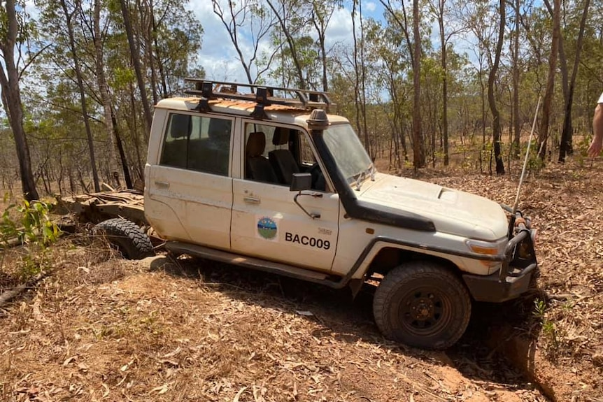 A white Toyota Landcruiser 4WD is seen smashed and damaged.