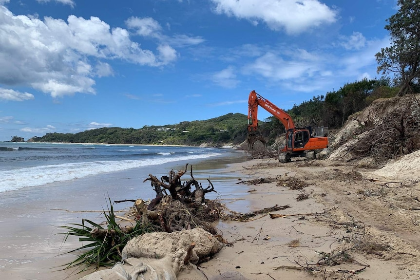 Heavy machinery is being used to clear debris and begin dune-stabilisation work at Byron Bay's Clarkes Beach.