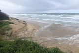 Small sand cliff at Old Bar Beach near Taree following wild weather off the Mid North Coast.