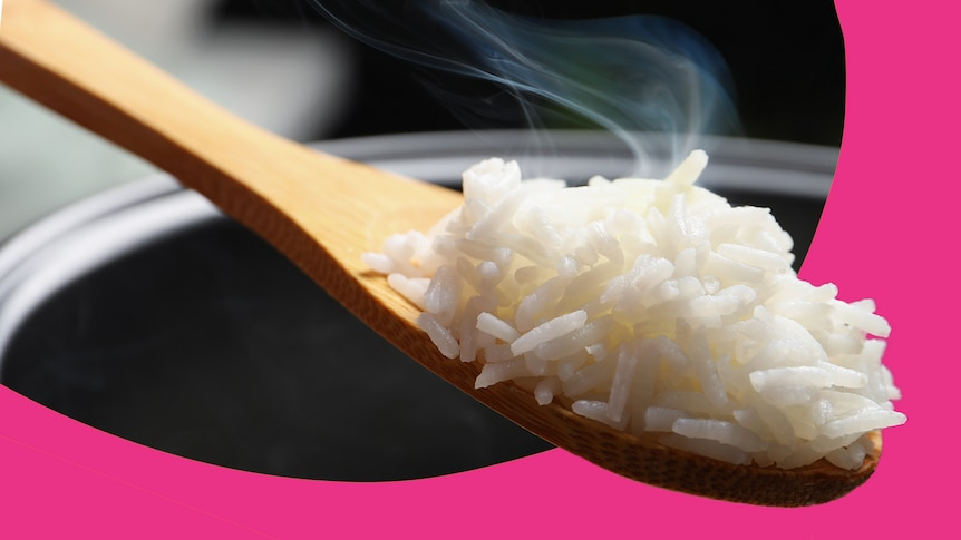 Wooden spoon with freshly cooked rice, depending on what you are making it might not need to be washed before use.