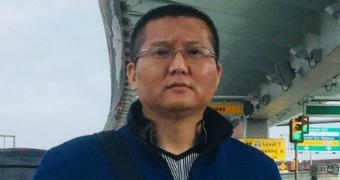 Zou Chengfeng stands under a bridge.