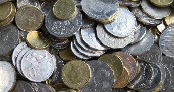 A pile of Australian coins on a table.