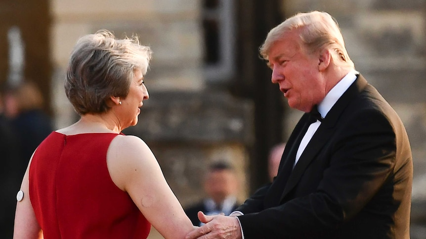 British PM Theresa May welcomes Donald Trump to the black-tie dinner at Blenheim Palace. (Photo: AP/ Ben Stansall)