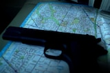 Gun laid down on map