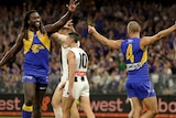 Dom Sheed holds both his arms out and Nic Naitanui moves to high-five him