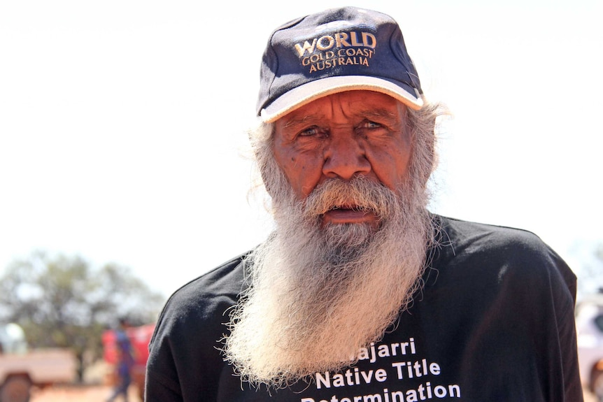 A bearded Aboriginal man looks at the camera