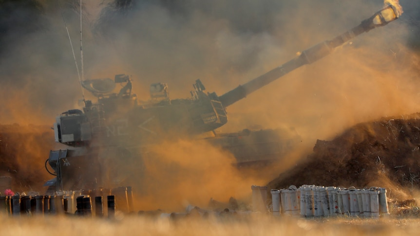 An Israeli artillery unit fires toward