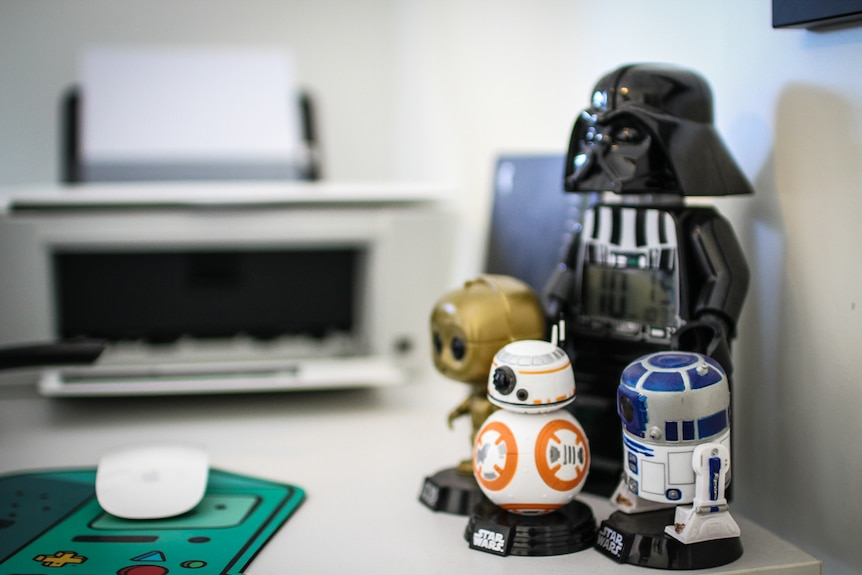Being a big fan of the space saga Chris Kennett's desk is adorned with Star Wars toys.