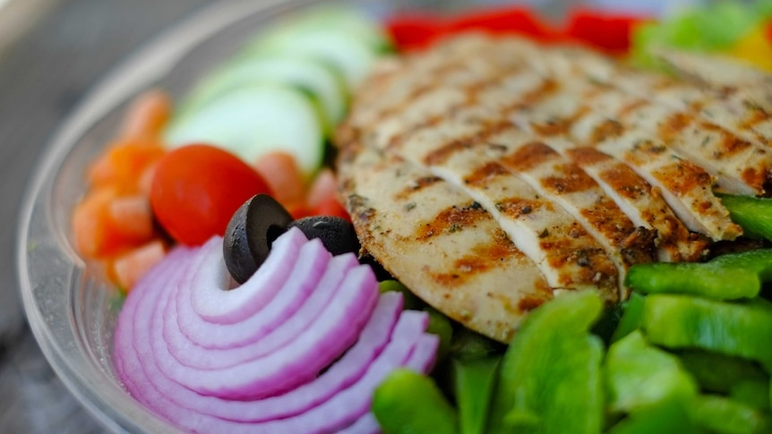 Lean meat and salad on a plate.