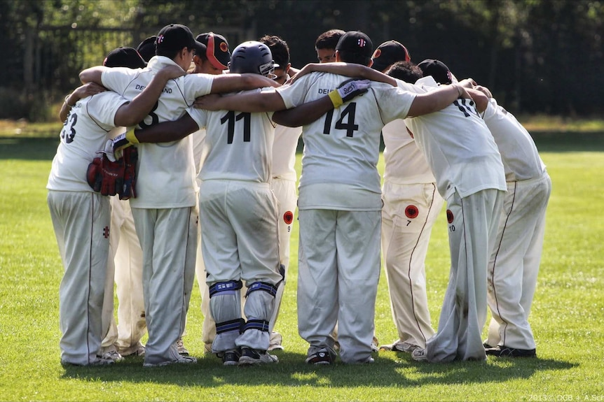 Germany under-19 cricket team in a huddle