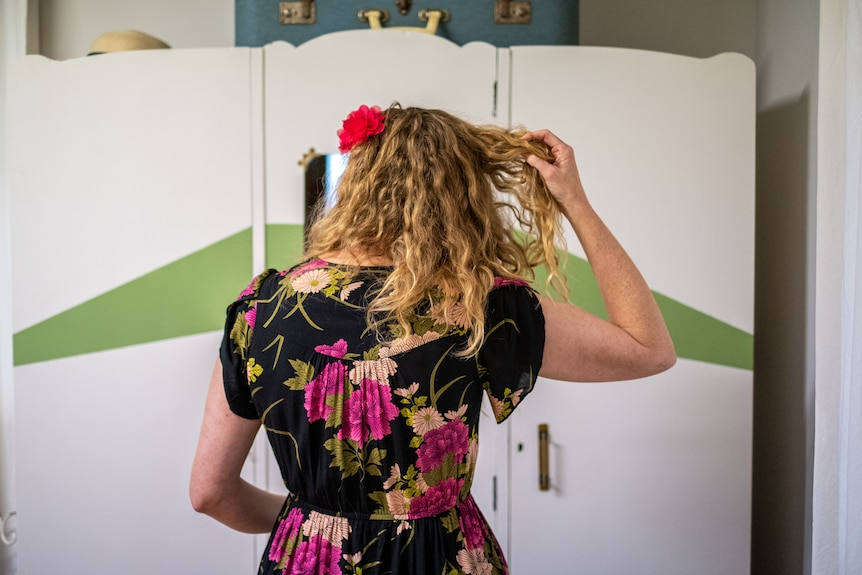 Amy Whitby fixing her hair