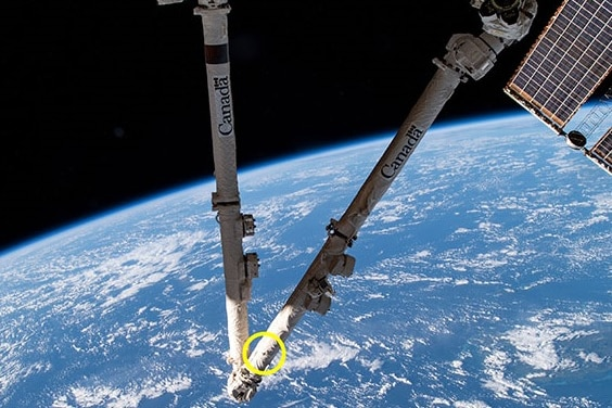 The impact of a piece of space junk hitting the International Space Station's robotic arm.