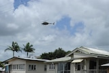 Defence Force helicopters fly over the devastated township of Grantham