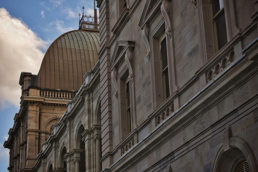 Close-up of sandstone of balcony and front of Parliament House in Brisbane.
