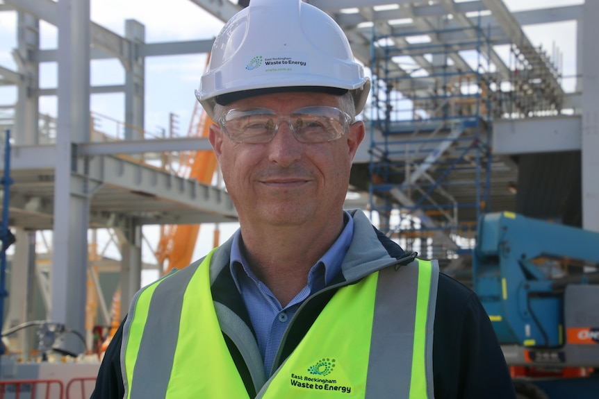 A close-up photo of Jason Pugh wearing a hard hat and high vis vest.