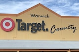 A man walks towards the front entrance of a Target Country store.