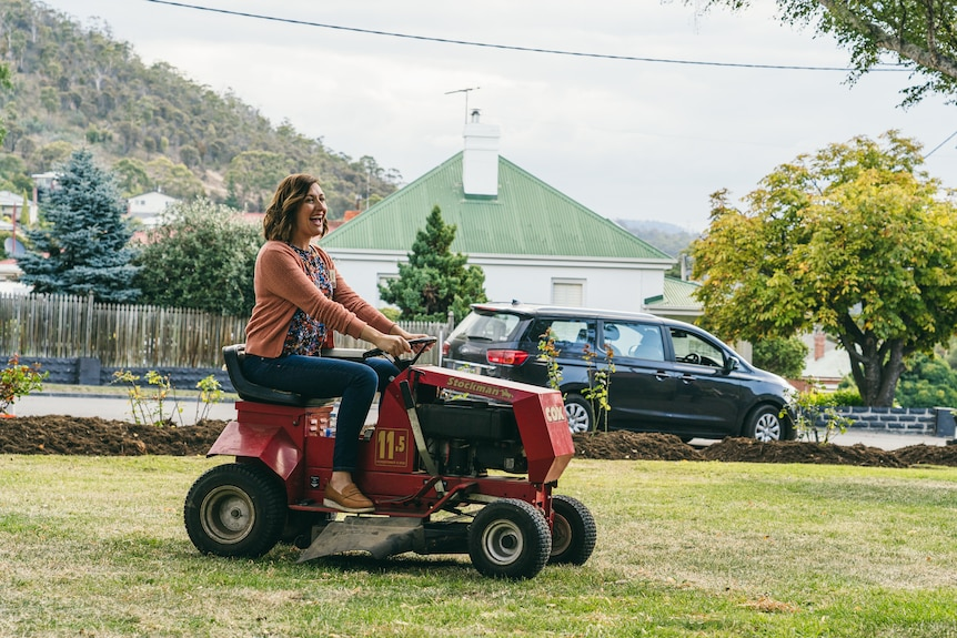 Celia Pacquola on a tractor on the set of Rosehaven.