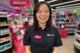 Eunice Wang works at Priceline. She is standing in the shop in her uniform.