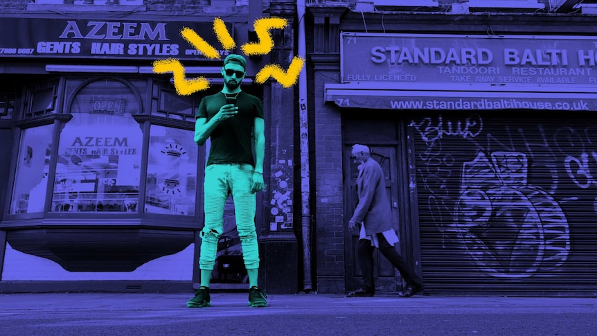 Poet Zohab Zee Khan standing on a London using his phone, for a story about minimising tech time.
