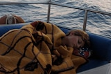 Woman sleeping on boat