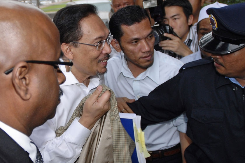 Malaysia's de facto opposition leader Anwar Ibrahim is led by police