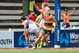 Adelaide's Erin Phillips gestures after kicking a goal against the Bulldogs in AFLW