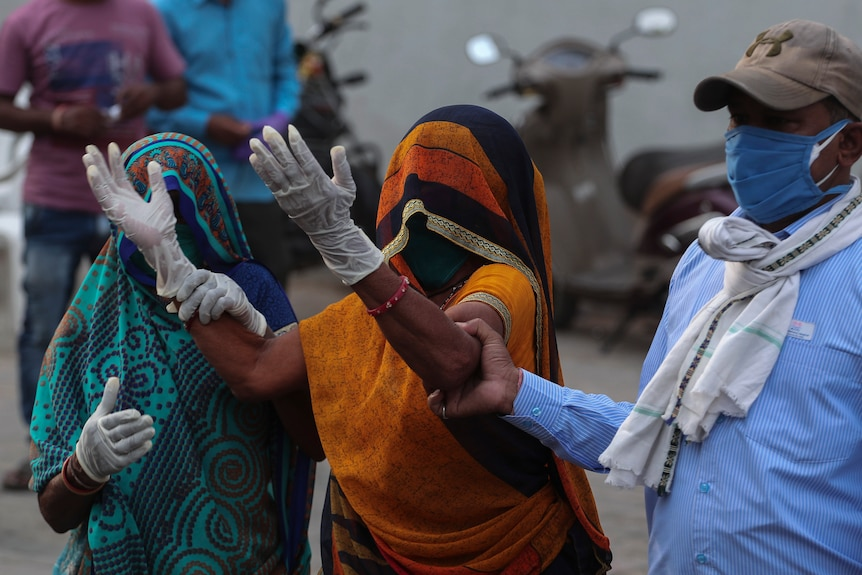 A relative of a patient who died of COVID-19, mourns outside a government COVID-19 hospital in Ahmedabad.