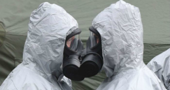 Two people in gas masks face each other in Salisbury