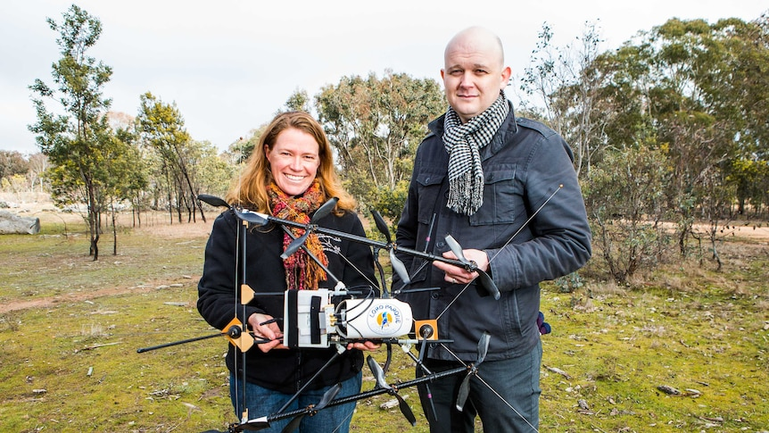 ANU researchers Debbie Saunders and Adrian Manning with the radio tracking drone they developed