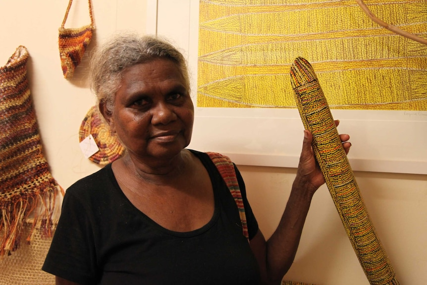 Artist Regina Wilson with her carvings, painting, and weavings.