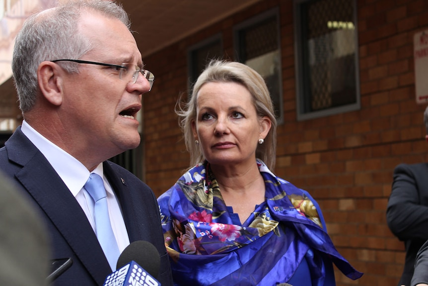 Liberal frontbencher Sussan Ley, on right, listens to Prime Minister Scott Morrison talk.