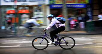 A cyclist makes his way to work in Melbourne on 'National Ride to Work Day'