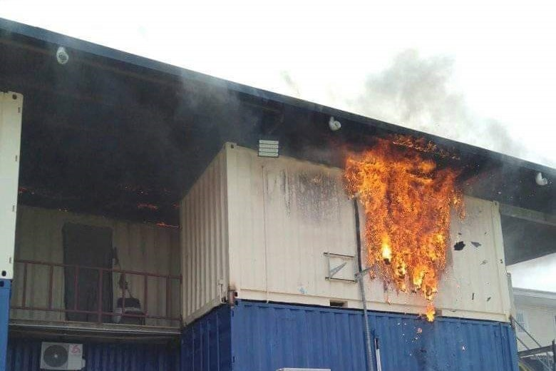 Fire engulfs a shippig container used as accommodation for refugees and asylum seekers on Manus Island, Papua New Guinea.