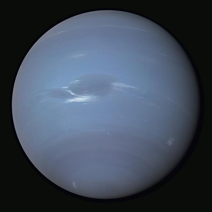 A view of Neptune, dark blue-purple in colour