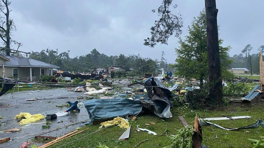 Debris covering the street in East Brewton, Alabama