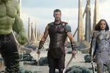 The Hulk, Thor, Valkyrie and Loki walk on a whrf