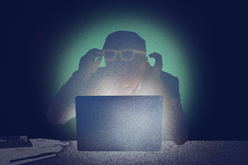 An illustration of a shocked man with both hands and glasses raised sitting at desk in front of a laptop in a dark room.
