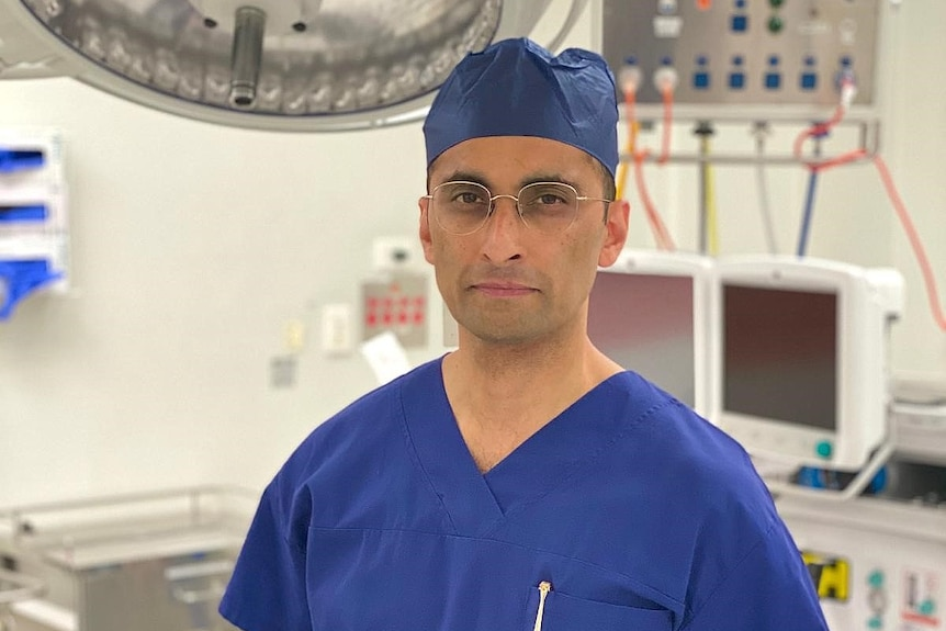 Sushil Pant stands in a surgery.