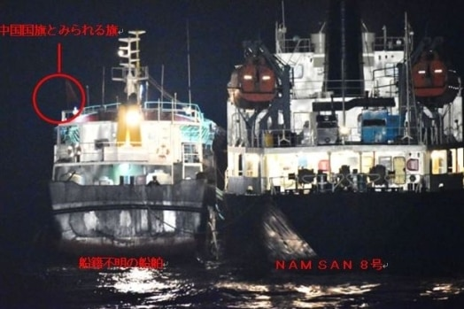 Two ships close to each other at night