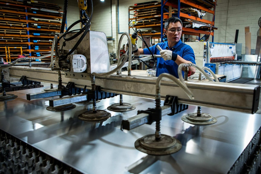 A man working on a machine in a factory