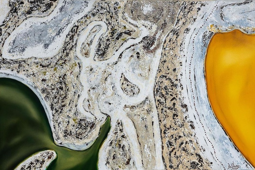 An aerial image of lakes and grassland