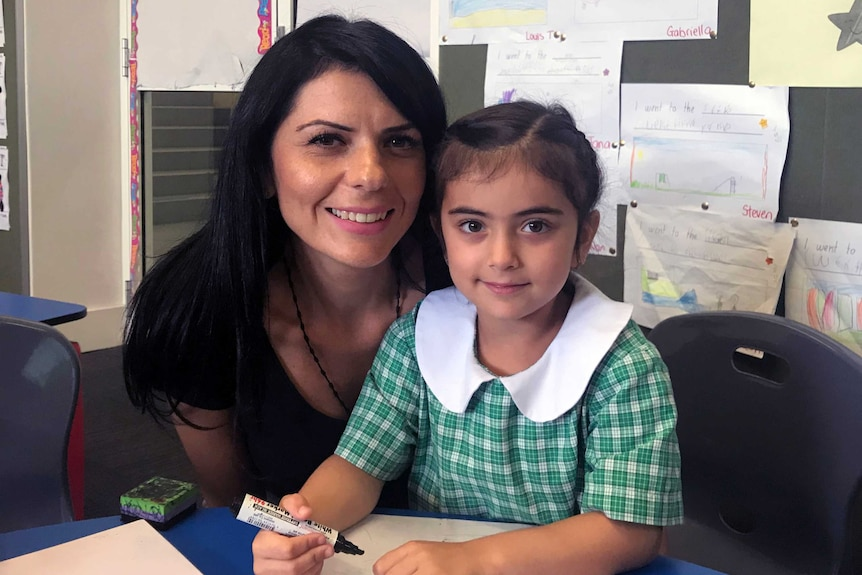 Mary Moussa with her daughter, who attends St Felix's Catholic Primary School