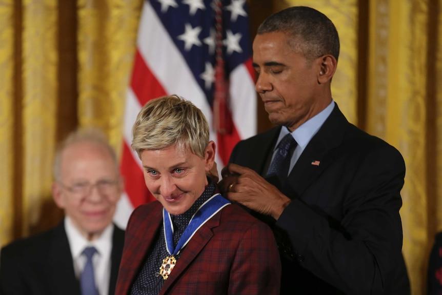 US President Barack Obama presents the Presidential Medal of Freedom to comedian and talk show host Ellen DeGeneres