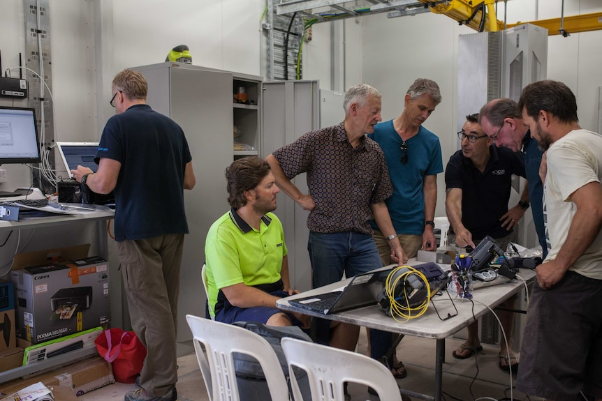 Vocus Communications staff inspect a new cable landing station on Christmas Island.