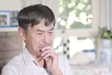 Xiaoming Li becomes tearful when he recalls his experience as a soldier during the Tiananmen massacre.