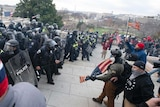 US Capitol Police push back demonstrators who were trying to enter the US Capitol.
