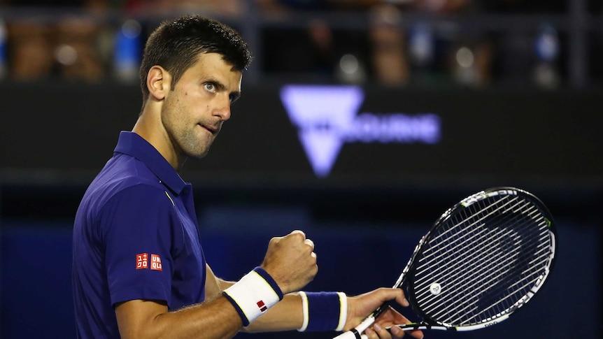 Serbia's Novak Djokovic celebrates point won against Roger Federer in Australian Open semi-final.