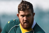 A Wallabies player holds the ball as he prepares to pass at a training session in Sydney in 2016.