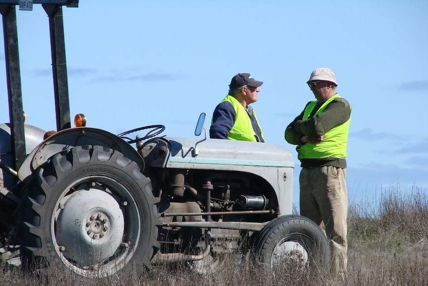 Two men and a tractor