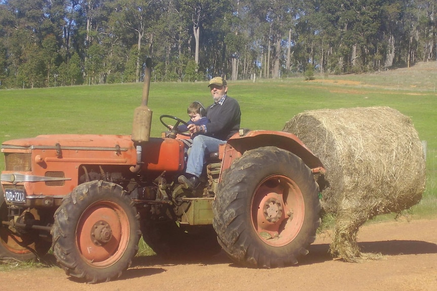 Gary Elks uses his tractor on a property in Western Australia.